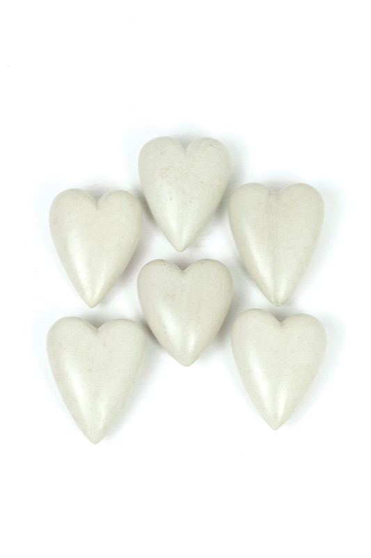 6 white hand-carved stone hearts