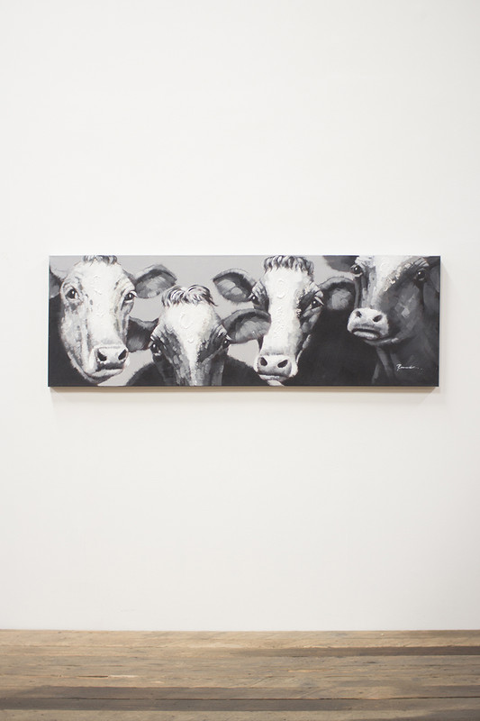 black and white four cows painting