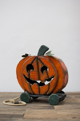 painted wooden jack-o-lantern pull toy