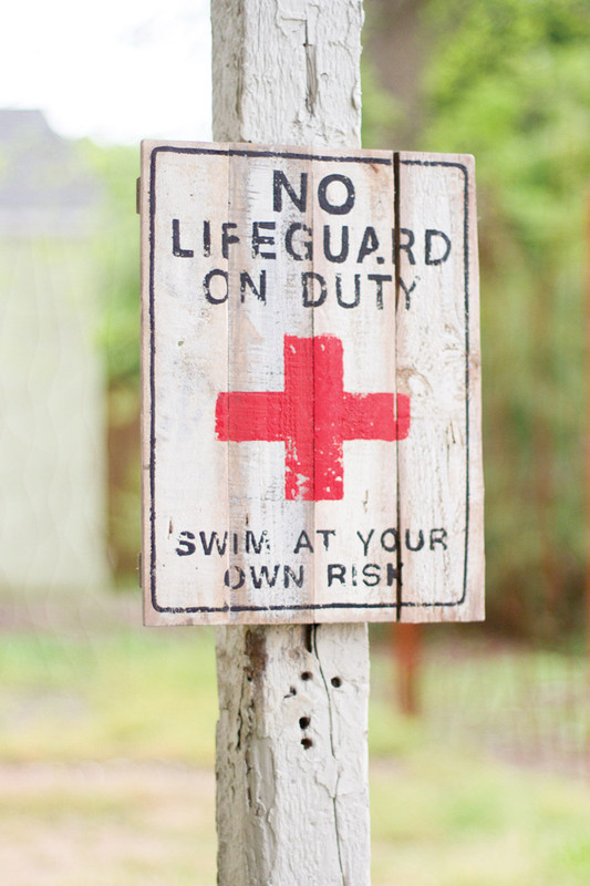 reclaimed wooden sign - no lifeguard on duty