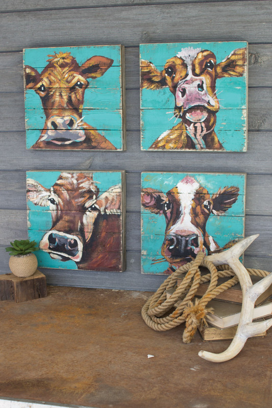 cow paintings on wood panels
