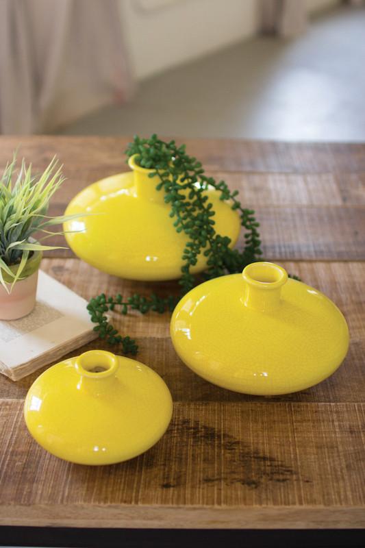 set of three yellow ceramic vases