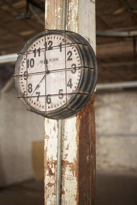 caged metal <i>new york</i> factory clock
