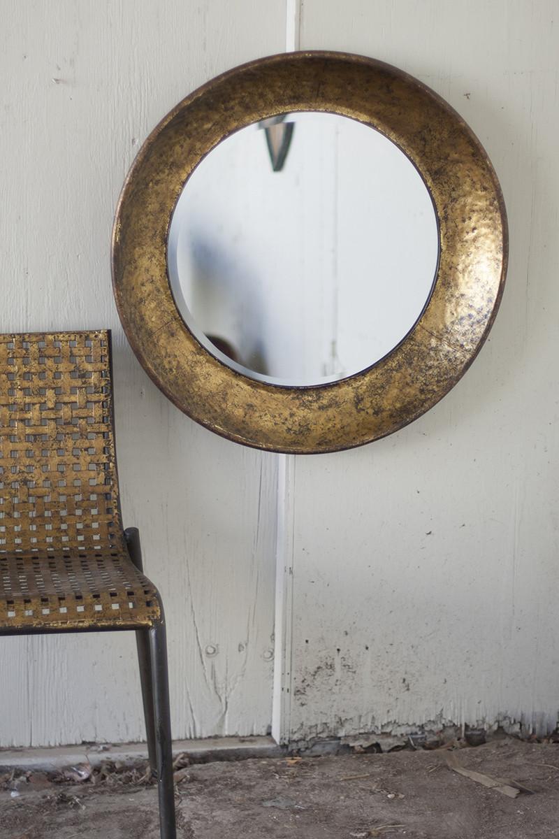 large round antiqued gold metal mirror