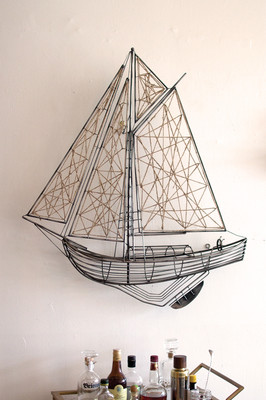 woven metal and jute sailboat sculpture