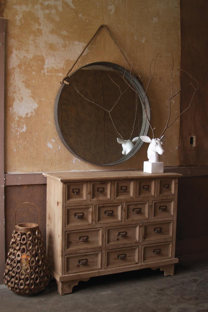 round metal mirror with rope