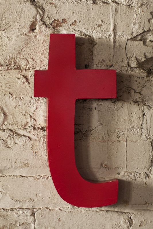 red metal letter - T