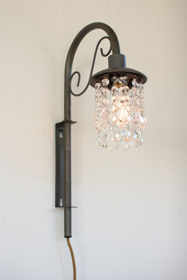 swinging wall sconce with gems