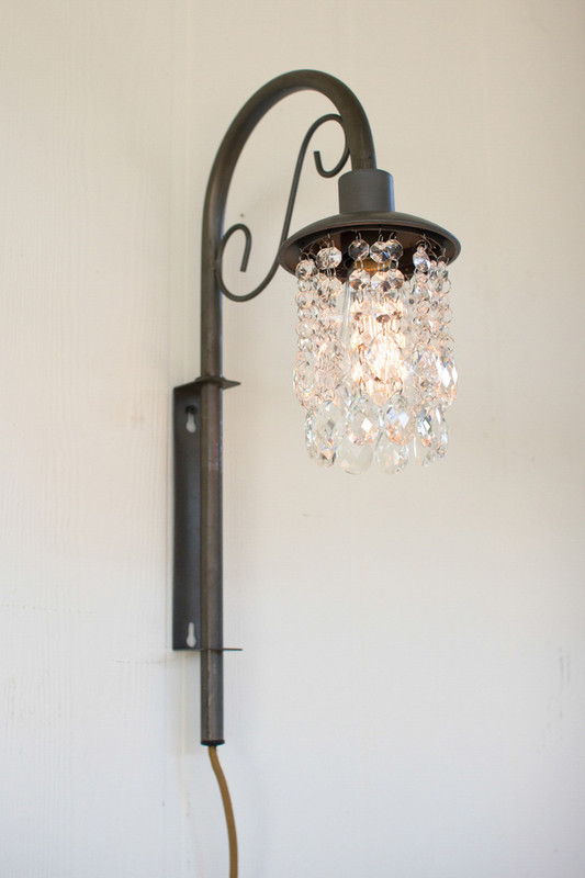 swinging wall sconce with glass gems