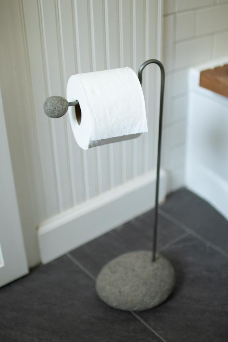 metal and river rock toilet paper stand