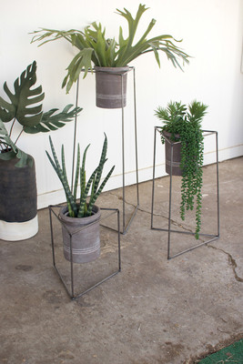 set of three nesting iron triangle planters with grey wash clay pots