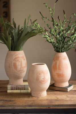 set of three clay pot faces