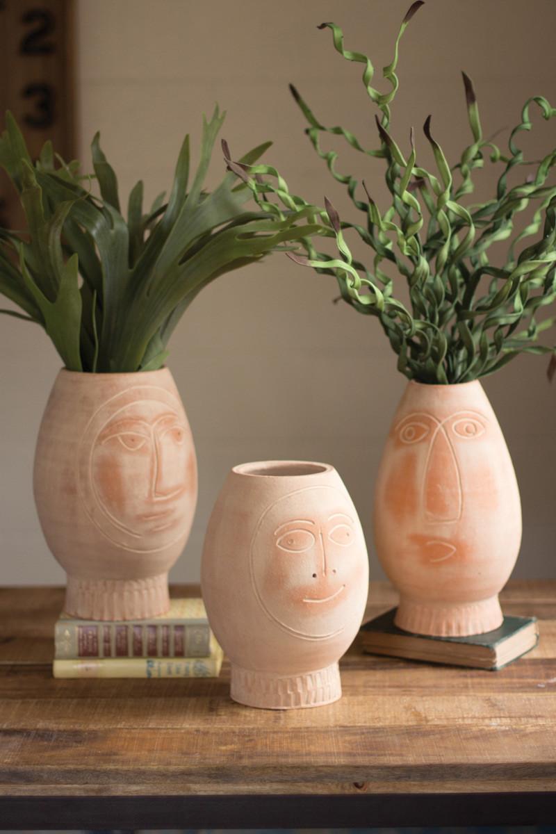 set of three clay pot faces