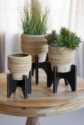 clay planters with black wood base