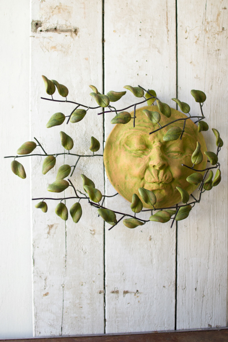 Wind Blown Sun Face With Clay Leaves Wall Hanging