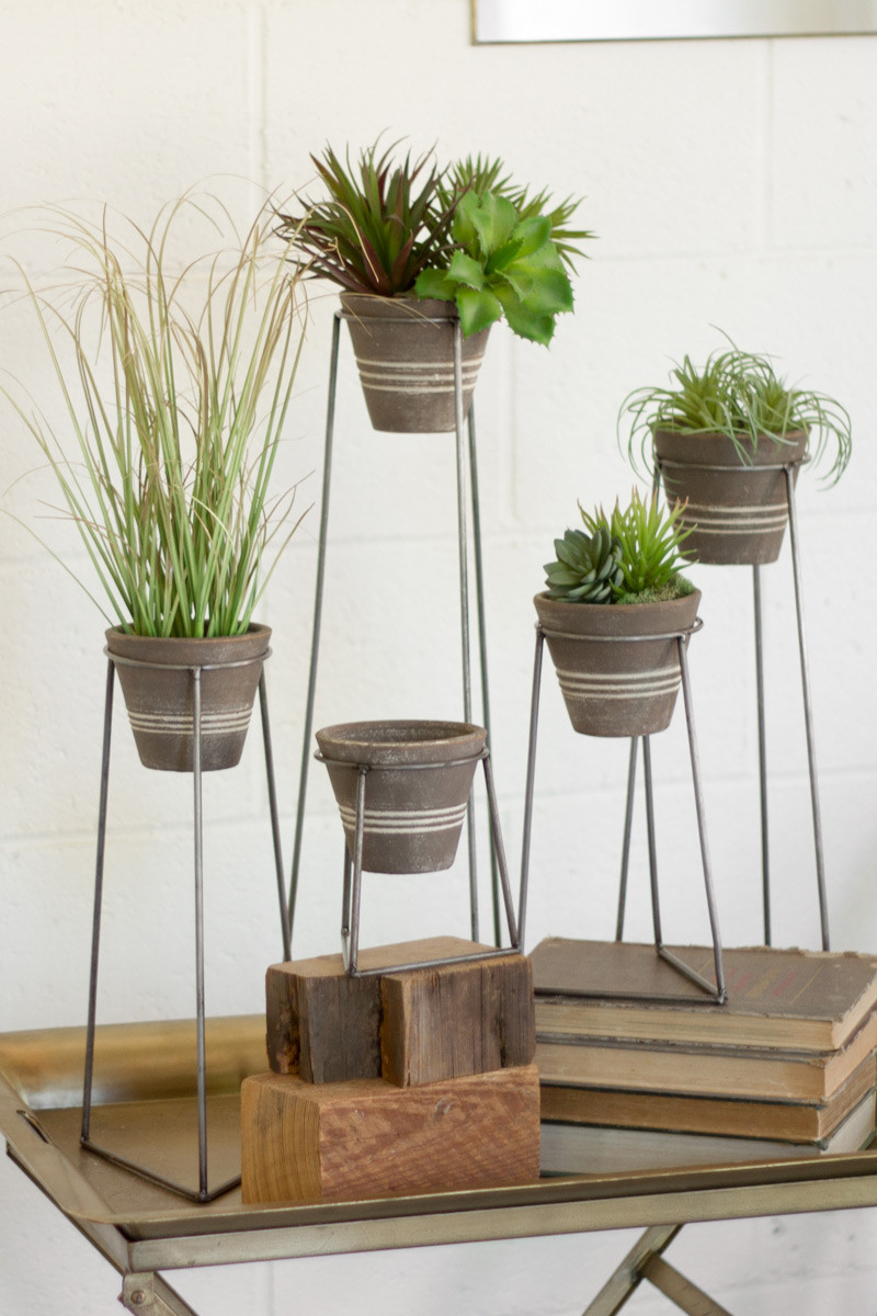 clay pots with wire bases