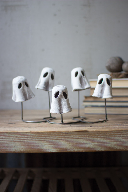 FIVE CLAY WOBBLY GHOSTS ON A STAND