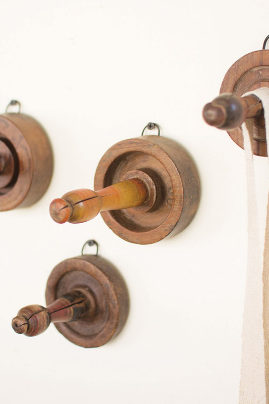 assorted set of four antique turned wooden coat hooks