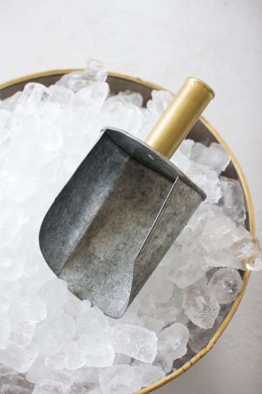 zinc scoop with brass handle
