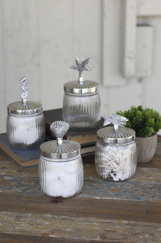set of 4 glass canisters with antique aluminum seaside lids