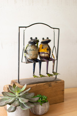 Two Recycled Metal Frogs on a Swing