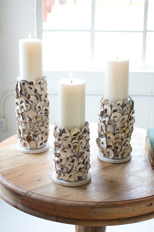 set of three oyster shell pillar candle holders